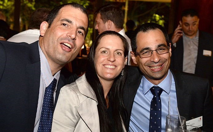 Meg Celebrating with our good friends Robert and Paul from Mangano IT at the after party.